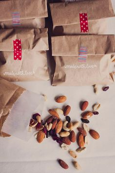 This is a great way to mix tradition into your D.I.Y. Wedding. Simply take trail mix, place it into small, wedding favor sized bags, and complete the look with trendy tape.