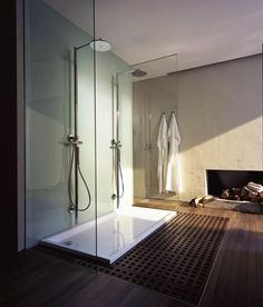 love the fireplace next to the open shower concept - nice architectural design!