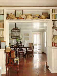 /\ /\ . India Hicks.       I'm liking the above separation from rooms.  Great ideas to help separate rooms without making a place seem smaller.  The clutter in this picture.... Almost kills it though.  I'd do glass cabinet drawers for an In between kitchen and dining room.