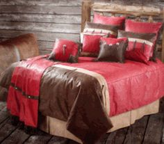 Gorgeous Western Tooled Burgandy bedding set. The comforter is quilted and overstuffed and super soft. Included are two pillow shams (twin has one),matching bed skirt and the three tassled fringe pillow.
