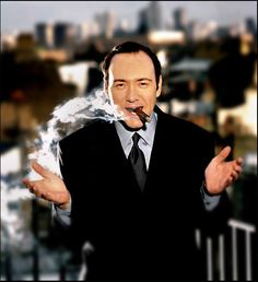 Kevin Spacey smoking a cigar. Awesome.  https://www.facebook.com/RousecoInc