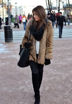 this girl can rock a fur coat, deffinately