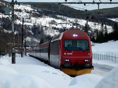Train hauled by is entering Gol station between the piles of snow, on its way from Oslo to Bergen. Rolling Stock, Bergen, Oslo, Locomotive, Norway, January, Around The Worlds, City, Vehicles