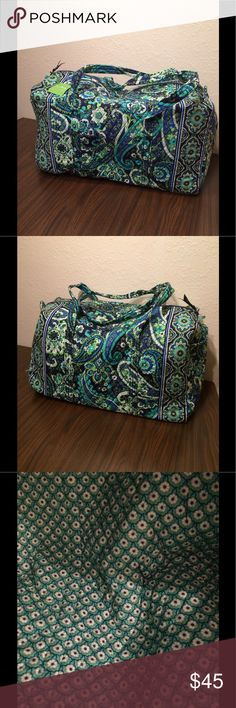 Vera Bradley Rhythm and Blues Large Duffel NWT Vera Bradley Large Duffel NWT. It has long straps and a slip in pocket on the end. Zippered closure. This comes from a smoke free and pet free home! Vera Bradley Bags Travel Bags