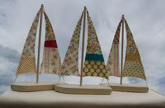 vintage quilt fabrics on wood boat sails