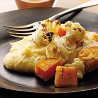 The polenta needs a bit more flavor, and would benefit from a bit of chicken, or maybe shrimp? The veggies are great, though. Roasted winter vegetables with cheesy polenta