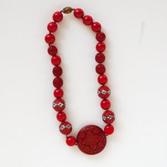 Hand Carved Vintage Cinnabar Necklace by VeraMaesCloset