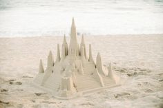 a sand castle for you princesses at heart! great idea for a beach wedding http://www.weddingchicks.com/2013/10/04/beach-wedding-in-pink-and-white/