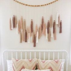 Our Oversized Tassel Garland brings natural, well-crafted detail to your space. Large tassels in a neutral palette make for a whimsical addition to your walls. Diy Tassel Garland, Beaded Garland, Boho Diy, Boho Decor, Diy Décoration, Diy Crafts, Decoration Bedroom, Diy Wall Decor For Bedroom, Diy Nursery Decor