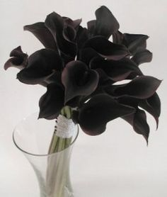 Bridal bouquet of black cala lilies - a switch from roses
