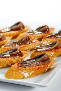 Pa amb Tomaquet with delicious anchovies from l'Escala. Catalonia