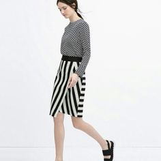 NWOT Zara Striped Asymmetrical Skirt ️Gorgeous striped skirt from Zara. New without tags. I wanted to use it,but it was too tight on me. Fits a 24.4 waist, 35.4 hips,  24 in long. Have only tried on. Outer shell 80% cotton 20% polyester. Black and white. Has a side zipper. Perfect to layer with a solid sweater! (I'm a 26-27 waist and it barely fits, so best for 24-26 in waist). Final price. Zara Skirts Asymmetrical