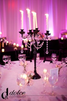 The black Nickie candelabra loos beautiful against the pink uplight background
