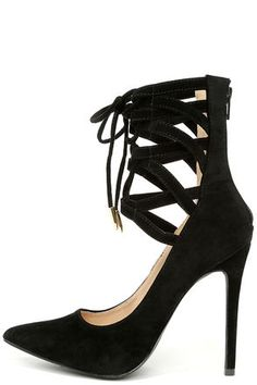 """Aim high and style your newest cocktail dress with the Lofty Ambitions Black Lace-Up Heels! These sexy vegan suede pumps are #trending, with a pointed toe, and a zippered high-rise shaft that combines caged details and laces (with gold aglets). 4.5"""" wrapped stiletto heel. Cushioned insole. Felted rubber sole has nonskid markings. Available in whole and half sizes. Measurements are for a size 6. All vegan friendly, man made materials. Imported."""