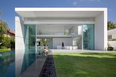 Tropical House Design With Pool Formed Rectangular Box That Forms The Main Living Area With Pillar Fully Glazed Facade Cubic Shaped House for Innovative and Modern Residence Style Home design http://seekayem.com