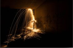 A Creative Light Painting Photograph That Makes Sparks Look Like Rain sparksumbrella 6