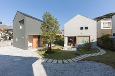 Completed in 2014 in Kamakura, Japan. Images by Shinkenchiku-sha. Two housing is designed from site division. Divides the land, it was decided to design a separate family are two for live house in Kamakura...