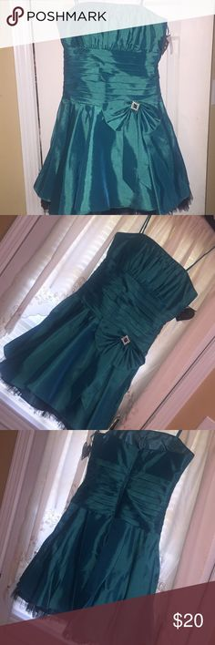 Formal Teal dress Formal Teal Dress. Spaghetti straps. Beautiful bodice. Short. Rhinestone in side bow. NWT! Perfect for a banquets, bridesmaid, prom, or any time of event. Dresses