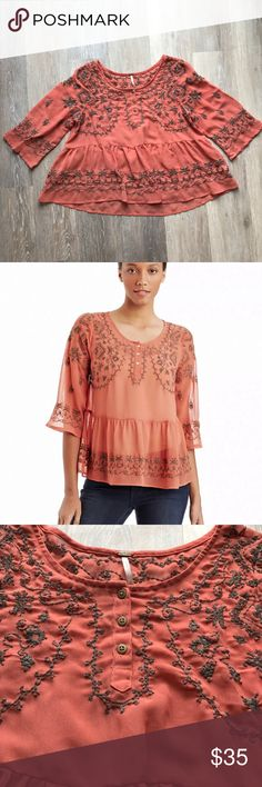 """Free People Top Pennies Sequel Embroidered Blouse Free People Top Pennies Sequel Embroidered  Gorgeous Rust sheer w/ light Brown embroidery  high low hem and baby doll/Peplum bohemian style  3/4 length sleeves Gorgeous and lightweight perfect for fall!!  A couple loose threads, but nothing major  Color: Rust Size XS Ptp 18"""" Length:  Front 21""""  Back 24"""" Free People Tops Blouses"""