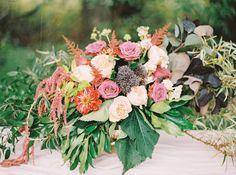 lush centerpieces - photo by Milton Photography http://ruffledblog.com/blooming-wedding-inspiration