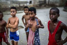 Young wrestlers listen to instruction from their teacher in a park in Old Havana, on October 15, 2014. (Ramon Espinosa/AP)