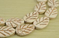 White Synthetic Turquoise carved leaf beads by luckybeadssupply
