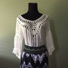 Perfect boho festival top Size medium wildcat white boho wildcat top. Beautiful fringe and crochet. V in the front and back. Very light fabric, breathable and semi sheer. Long so works with leggings. Smoke free home and 15% off bundles. Wildcat Tops