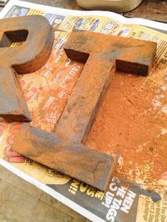 Create your own rust - an easy technique that just requires paint and cinnamon! by It's Just Me  Use this on the letters we created.