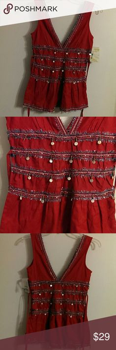 """Beautiful New Free People sleeveless Top NWT Free People women's top. It is adorned with beads and buttons. Comes with a tie strap on each side to cinch the top in the back. Comes with extra buttons and beads.  Measurements:  Outside shoulder straps - 11 1/2"""" Armpit to armpit - 14 1/2"""" Shoulder to hem - 26"""" Tie straps - 23""""  Comes from pet/smoke free home.  Thanks for visiting. Free People Tops Blouses"""