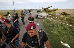"Armed pro-Russian separatists stand guard at a crash site of Malaysia Airlines Flight MH17, near the village of Hrabove, Donetsk region July 20, 2014. Ukraine?on Sunday accused separatist rebels of hiding evidence that a Russian missile was used to shoot down the Malaysian airliner, while Britain said?Moscow?faced ""pariah"" status and the threat of further economic sanctions."