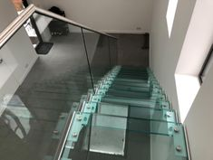 This is a modern straight flight staircase featuring a glass balustrade.