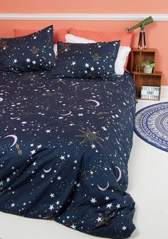 Star-Crossed Covers Duvet Cover in Full/Queen | Mod Retro Vintage Decor Accessories | ModCloth.com  Envelop your comforter in this stellar duvet cover before drifting off into a blissful sleep. Decorated with white stars and golden constellations against a midnight blue sky, this ModCloth-exclusive bedding was fated to be with your starry-eyed dreams!