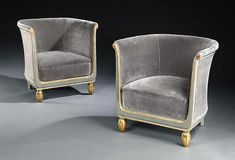 Pair of Art Deco club chairs, each upholstered within a grey and gilded frame; French, circa 1920s