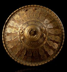 Africa | Shield from the Amhara people of Ethiopia | Leather, wood and decorated with metal elements
