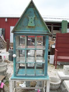 old windows....terrarium, greenhouse  or   a  great  showcase  for a store...