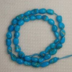 Sleeping-Beauty-Turquoise-Small-Pebble-Beads-9-Strand-Craft-or-Jewelry-512