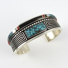 Cuff | Albert Nells (Navajo).  Sterling silver, turquoise, coral, black jade and mother of pearl