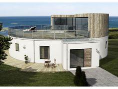 """Emrahus award winning passive house """"Villa Atrium"""" in Borlänge, Sweden. Round house, round walls."""