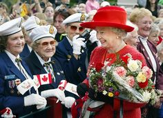 Daily Mail: Queen Elizabeth II carries a bouquet of flowers during her Golden Jubilee Tour of Canada in 2002