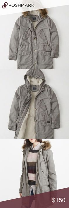 Sherpa lined twill parka Heritage inspired parka with soft, cozy sherpa lining, mid thigh length, lined pockets for extra warmth, removable faux fur hood trim,  waist-cinching draw cord, rubbed cuffs and zipper front. Never been worn 💕 feel free to make an offer Abercrombie & Fitch Jackets & Coats