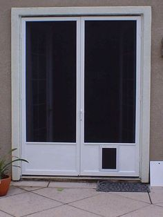 steel french doors with doggie doors dark shaded screen for the storm door and the doggie