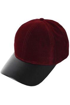 """This season's hottest trends combined: casual baseball hats and velvet! Burgundy velvet cap with vegan leather visor. Velcro back. 24.5"""" Circumference, 8"""" Diameter, 4"""" Tall."""