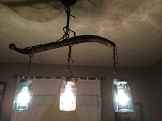 Using Mason Jars and a Horse Harness ( Hames Collectable) to Create a Rustic Chandelier.