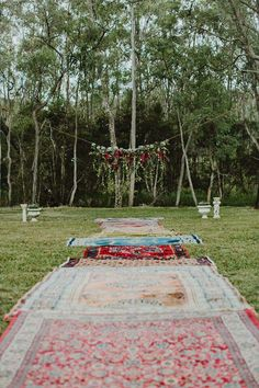 Vintage rugs down the aisle, with a beautiful falling flower arrangement waiting at the end..perfection!