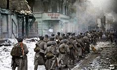 Soviet troops marching through the city of Schneidemule, February 1945.