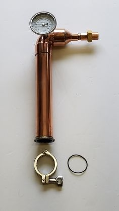 These x still heads include a thermometer and a stainless steel tri-clamp & gasket. It can be easily necked down to copper pipe or copper tubing for a worm coil. These will work on most beer kegs and our 2 inch kettles. Moonshine Still Kits, Copper Moonshine Still, Homemade Moonshine, Beer Keg, Pot Still, Home Brewing Beer, Copper Tubing, Distillery, Liquor