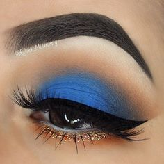 Matte electric blue eyeshadow with gold glitter eyeliner