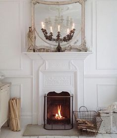living room with white ornate molding and fireplace. Vintage Fireplace, White Fireplace, Fireplace Design, Fireplace Mantels, Fireplaces, Victorian Fireplace, Fireplace Mirror, Home Interior, Interior Decorating
