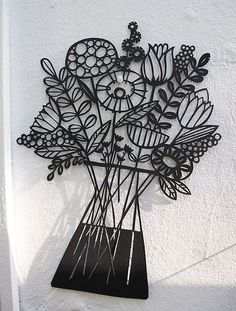 Flowers papercut... I wonder could I lay wax paper or even plastic wrap over a design then use white glue that I color towhatever color I need, trace the outline, let dry the either transfer to a glass surface or mount onto cardstock or wood.  HMMMMMdse