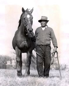 Man o' War and Will Harbut.  Will had never seen Man O' War race, but at the time he became the stallion's handler he certainly knew he was rubbing a living legend. Did Will also know that he had just met his soul mate, a thoroughbred who would make Will his (equine) family? Perhaps not in that first meeting, but I would wager that it wasn't long before both horse and man knew that they had found the truest expression of themselves in the light of the other's eye.